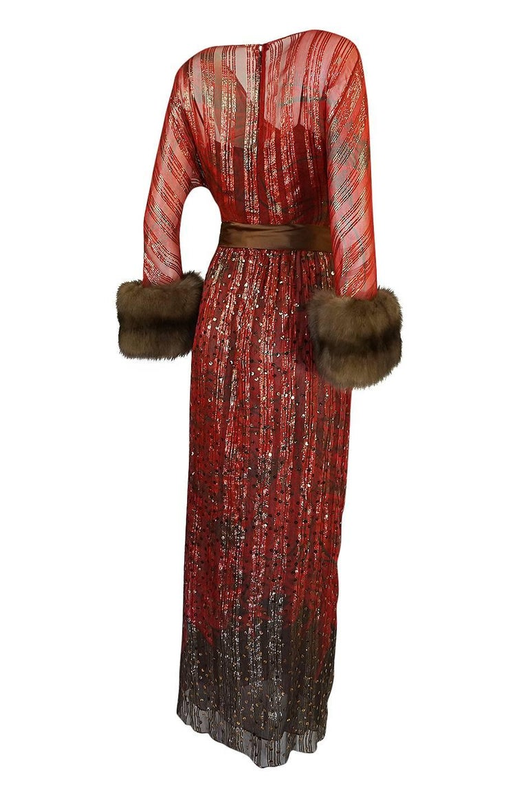 This beautiful dress is by Bill Blass and is magnificent. The dress has elements of his work that he would touch on continuously over the coming decades and really shows how sophisticated and glamorous he could be. The silk chiffon he used for the