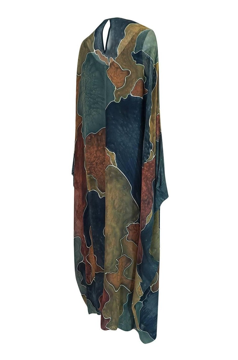 This amazing caftan has no tags in it but is very well made and has the feel of a labelled piece. There are actually three parts to it - a blue silk inner slip, the caftan itself and a matching scarf that is edged in large paillettes. I have shown