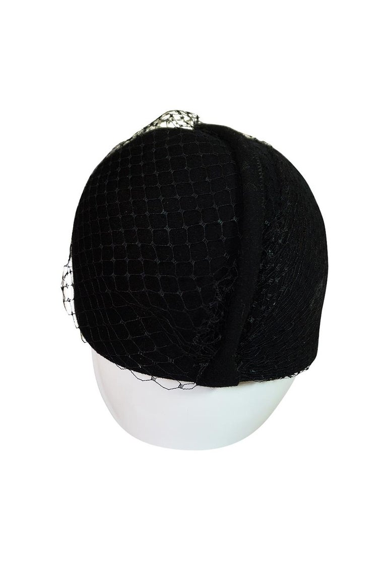 This has a very Bianca Jagger feel and perfectly captures that moment in the seventies when hats were all the rage for evening. It has a a slight nod to his famous pill box of the 1960s with a touch of thirties high glamour with its black net