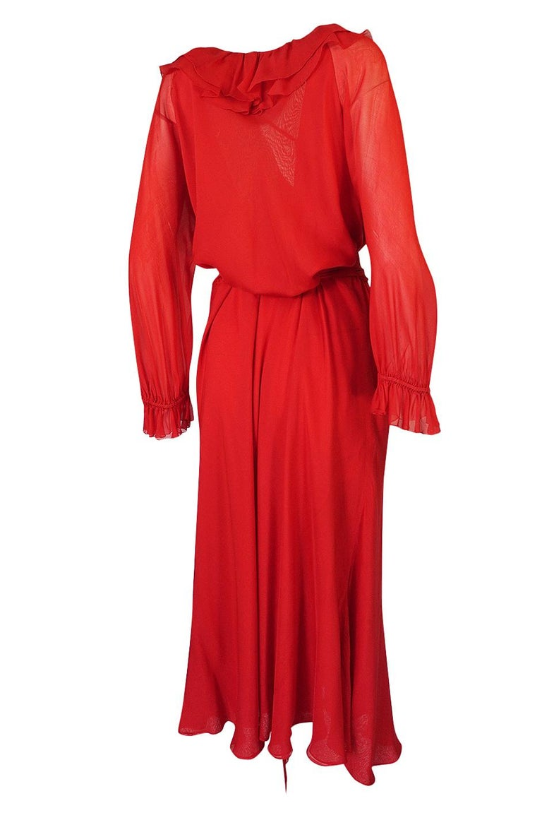 This wonderful red silk chiffon Halston dress is a beautiful example of his work during this time period. He was a master at combining function and ease but without sacrificing glamour. He did this with the very minimum of seaming. His pieces that