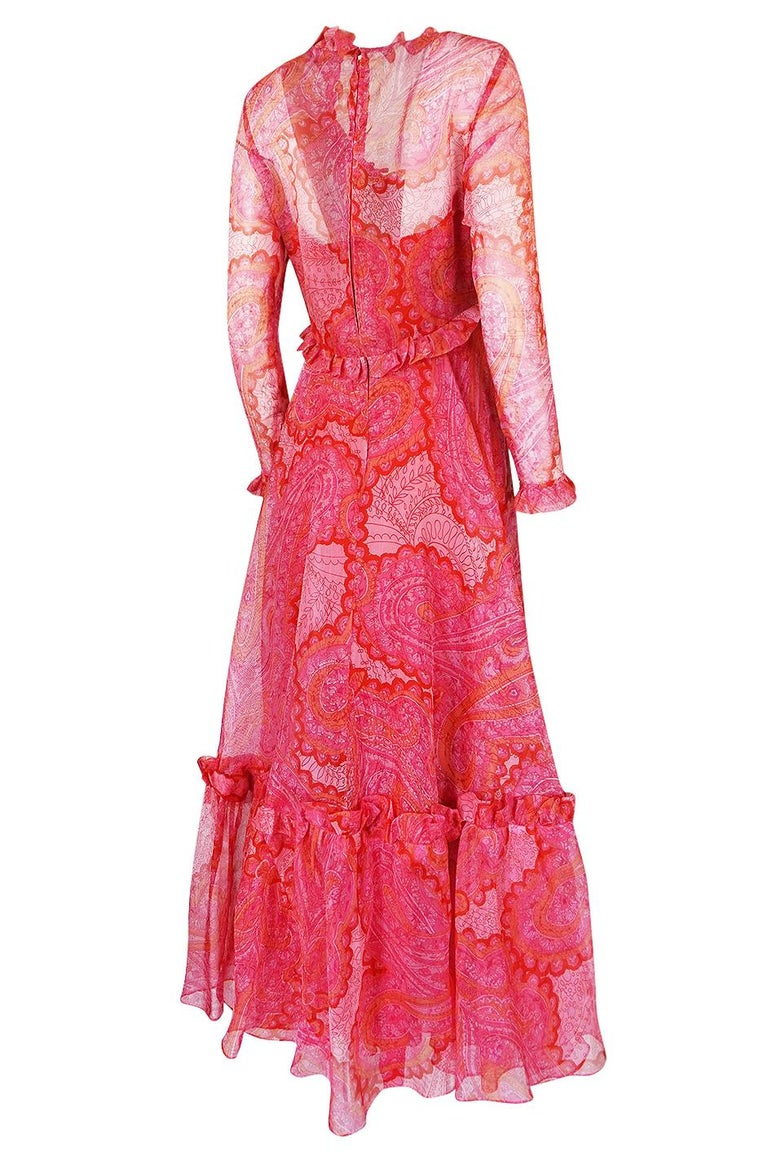 This wonderful pink silk voile dress is from the Nina Ricci Boutique ready to wear line. When hunting for a reference to date it by, I happened across a photo from 1976 that has a Ricci dress in a very similar print, color and ruffle trim finish.