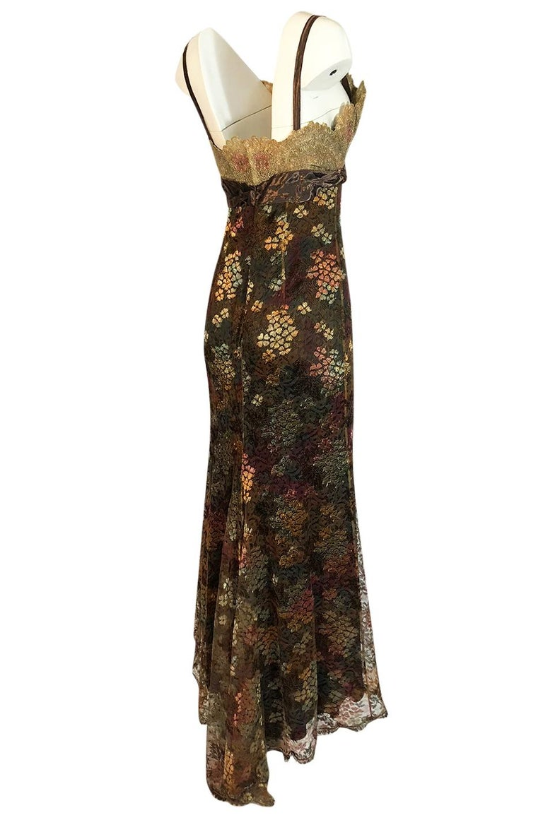 This Christian Lacroix dress perfectly showcases his mastery in combining colors, fabric and textures. Every element on the gown has a depth and texture to it separate from the others and yet it all works perfectly together. A version of this dress,