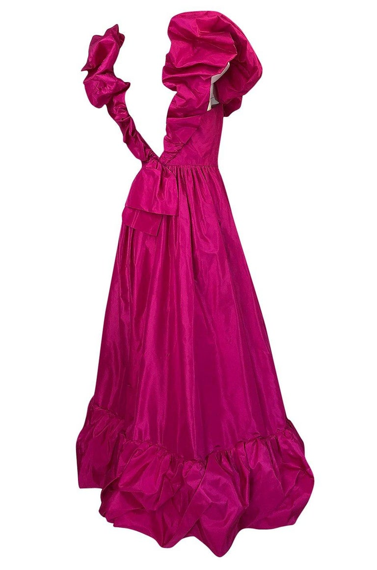 This wonderful dress is made from a bright pink silk taffeta. It is a dramatic statement piece that will turn every head when you walk into a room. Loris Azzaro was a favorite of actresses like Raquel Welch and Sophia Loren and he quickly gained