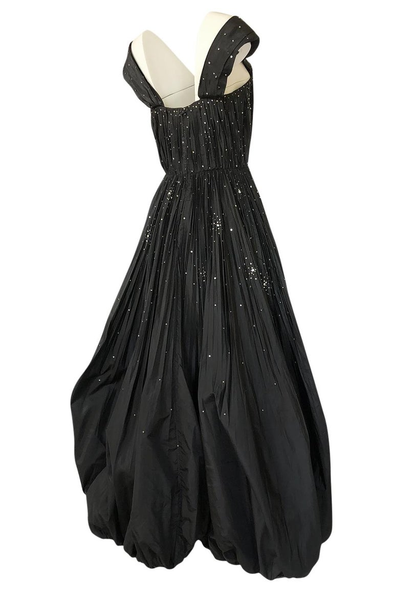 This gown is exceptional and it is a testament to the tailoring skills and vision and the man who would become the appointed designer to the Queen of England. Norman Hartnell was one of the British Couturiers who dressed the royals and the