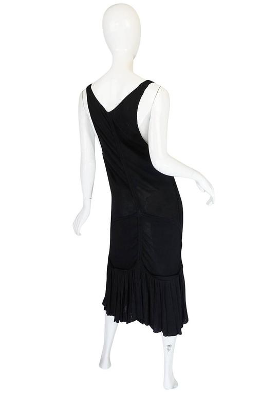 Insanely sexy, this low scooped front Azzedine Alaia dress from the 1990 collection has that in your face sensuality  that Alaia is known for. It is made form his signature bandage knit so it clings and hugs the body and your every curve. This one