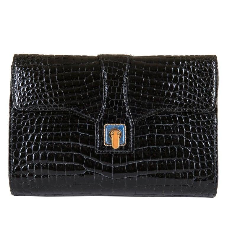 5e30c25a0dd1dc In pristine condition, this Gucci Black Crocodile 22cm Clutch is the  epitome of luxury &
