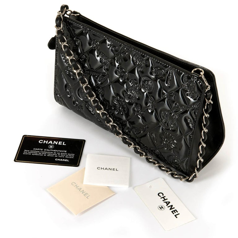 0712101f A Rare Pristine Chanel Black Patent Leather 'Lucky Charms' Evening Bag