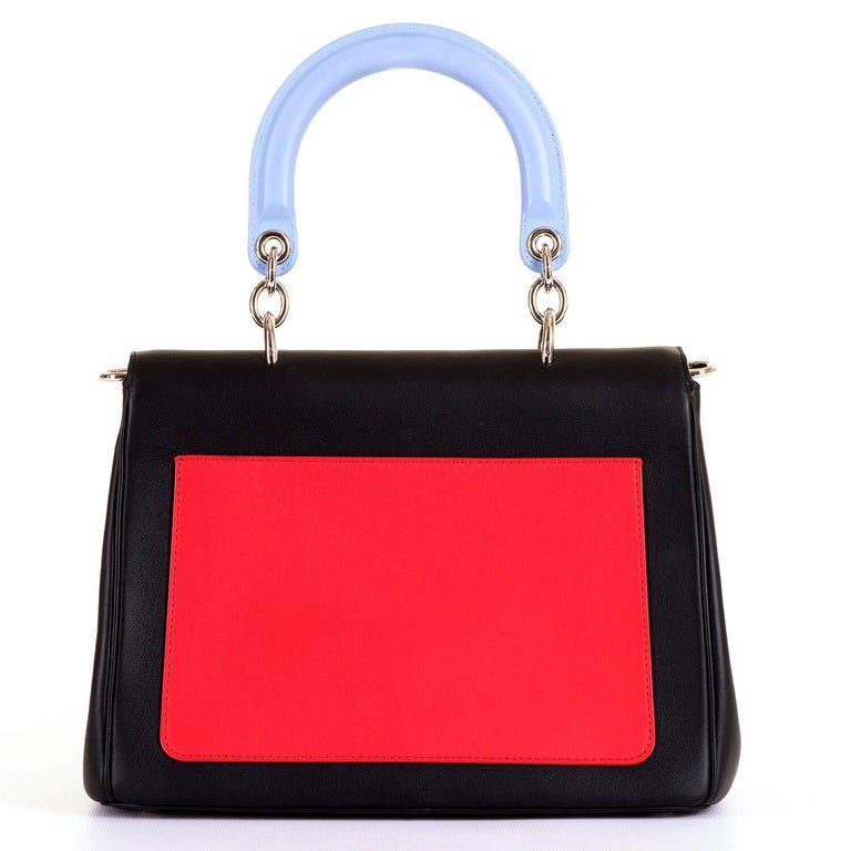 A simply stunning Rare, Limited Edition, Dior 'Be Dior' tricolour Handbag & Shoulder Bag. In pristine 'Store-Fresh' condition the bag is finished in Matt Black, Poster Red & Wedgwood Blue, enhanced with Silver Palladium Hardware. The double-flap bag