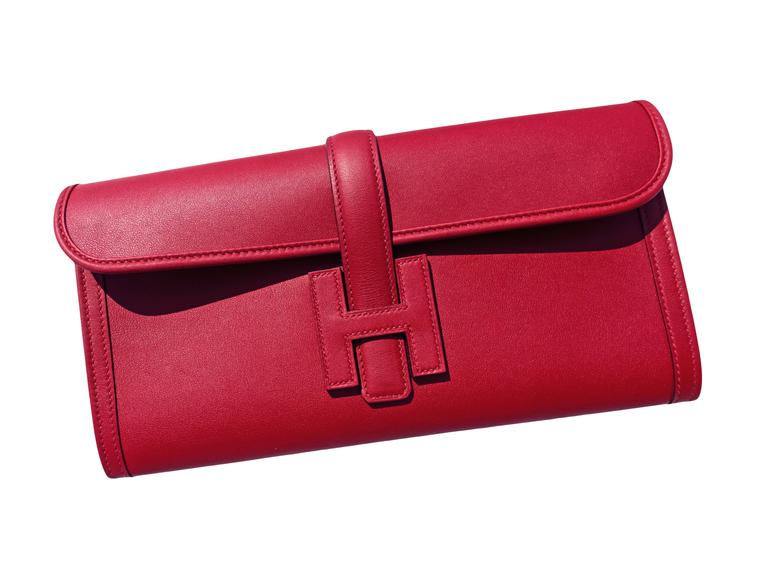 Hermes Rouge Grenat Jige Elan Clutch 29cm Red Garnet Jewel Perfect Gift!  Brand New in Box. 2016 store fresh bag with interior X stamp. Comes in full set with Hermes dust bag and Hermes box. The latest color Rouge Grenat is a must-have
