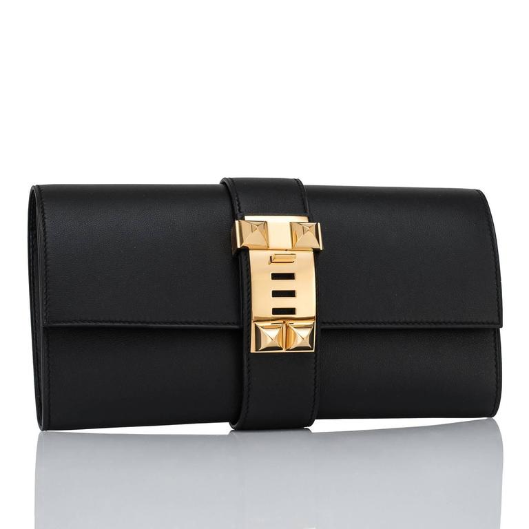 Hermes Black Medor Pochette 23cm Clutch Gold Hardware Bag Elegant Perfect gift! Comes with Hermes sleeper, Hermes box, and Hermes ribbon. Brand New in Box.  Store fresh.  Pristine condition- no plastic on hardware. Very rare production of Black