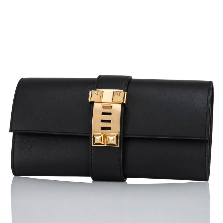 Women's or Men's Hermes Black Medor Clutch Swift Leather Gold Hardware Elegant For Sale
