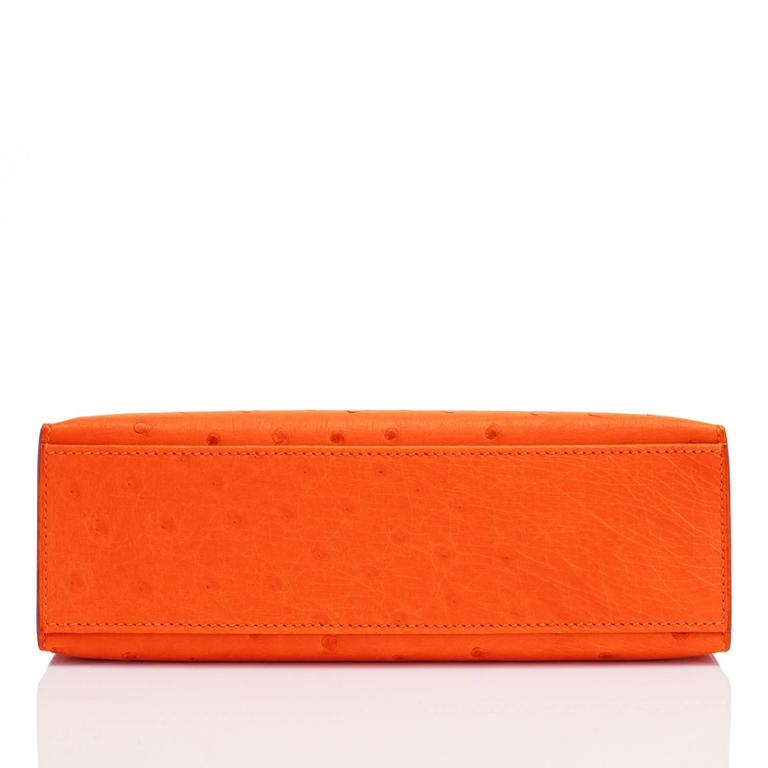 Women's Hermes Tangerine Ostrich Mini Orange Gold Hardware Kelly Pochette   For Sale