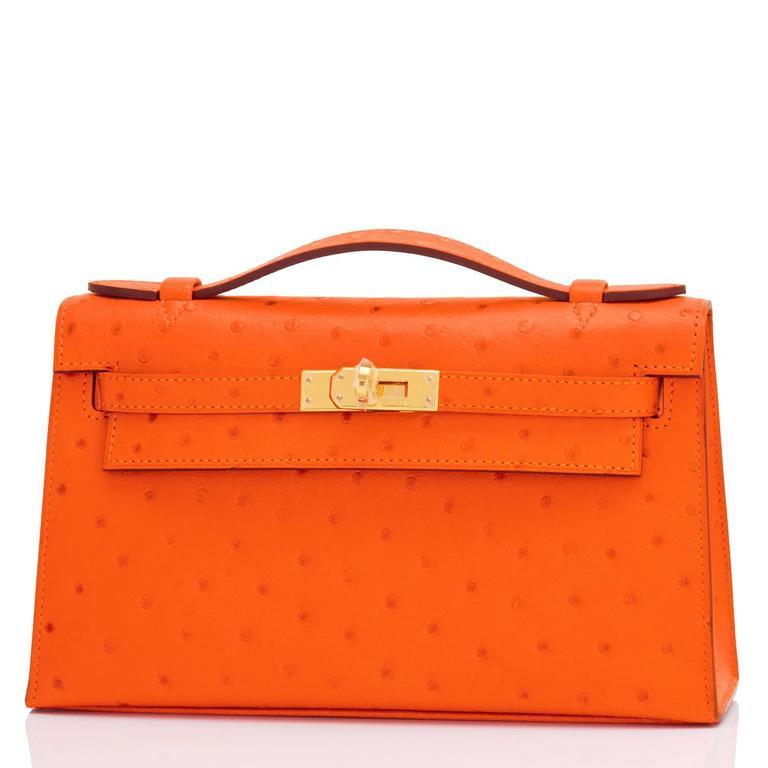 87e1fece5f23 Hermes Tangerine Ostrich Mini Orange Kelly Pochette Gold Hardware Brand New  in Box. Store Fresh