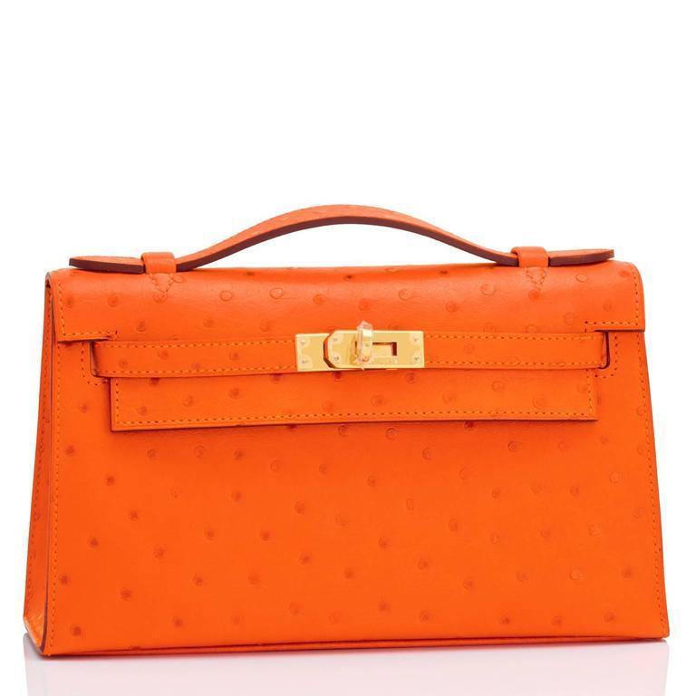 Hermes Tangerine Ostrich Mini Orange Gold Hardware Kelly Pochette   In New Condition For Sale In New York, NY