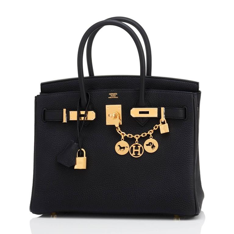 Hermes Black 30cm Birkin Bag Togo Gold Hardware Chic  Brand New in Box. Store Fresh. Pristine condition (with plastic on hardware) Perfect gift! Comes full set with keys, lock, clochette, a sleeper for the bag, rain protector, and  orange Hermes