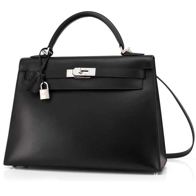Hermes Black Box Kelly 32cm Shoulder Bag Palladium Hardware  Black Box Kelly is modern and sexy set with fresh palladium hardware. In a perfect 32cm Sellier which holds almost as much as a Birkin 30, while lending a flawless architecture to any