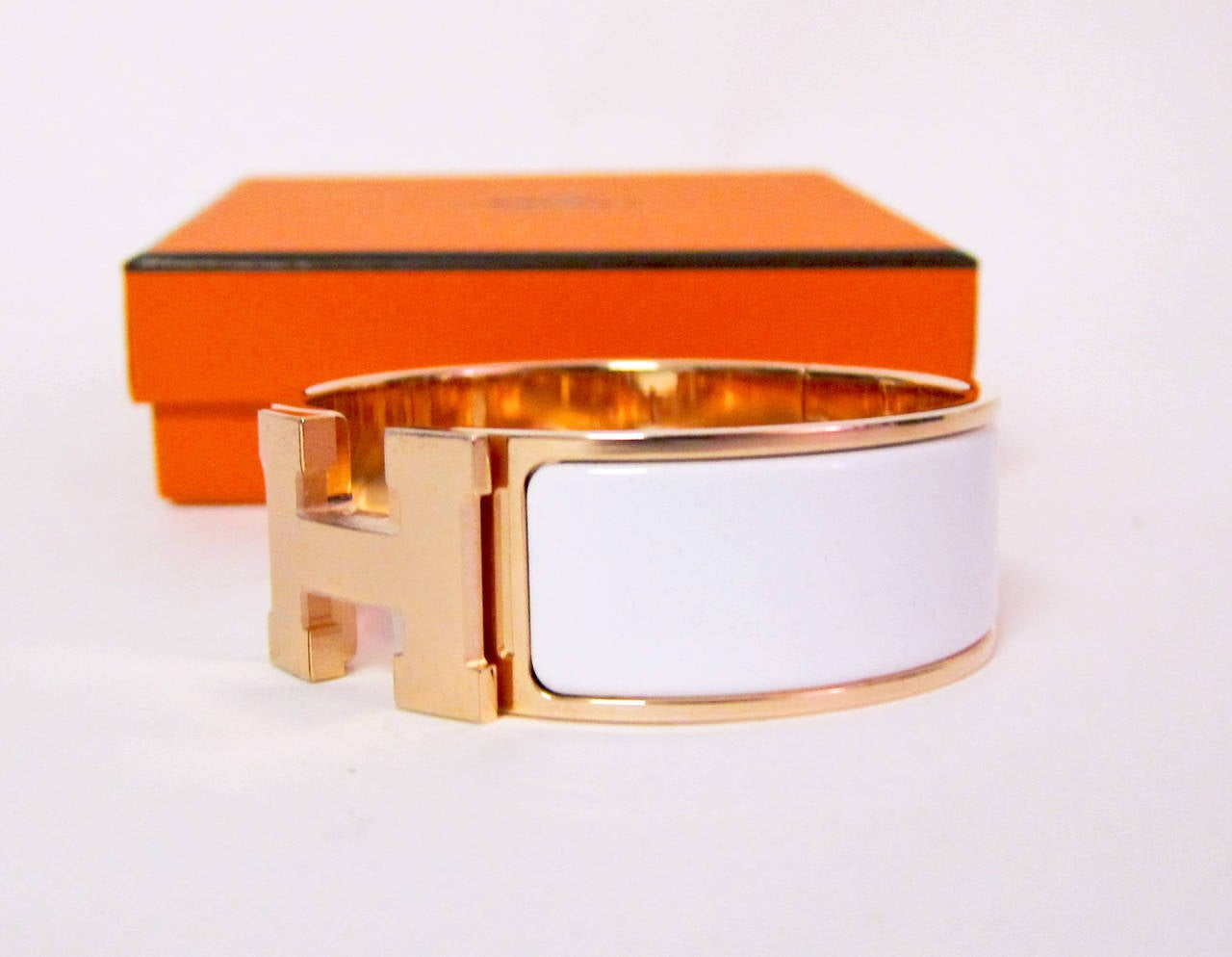 hermes white with gold clic clac enamel bracelet pm wide dreamy at 1stdibs