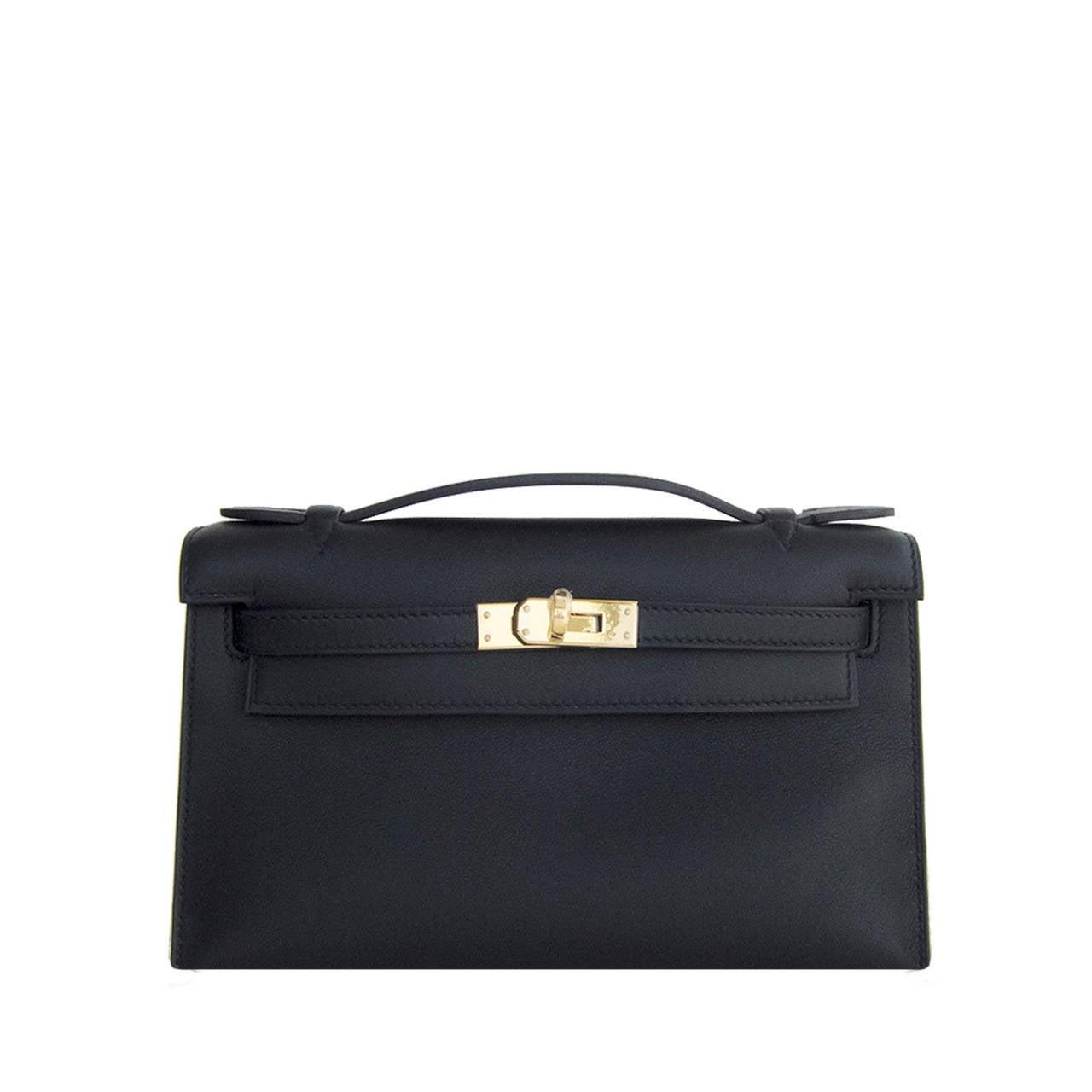 Fashionista Fave Hermes Black Gold Swift Kelly Pochette Cut Clutch ...