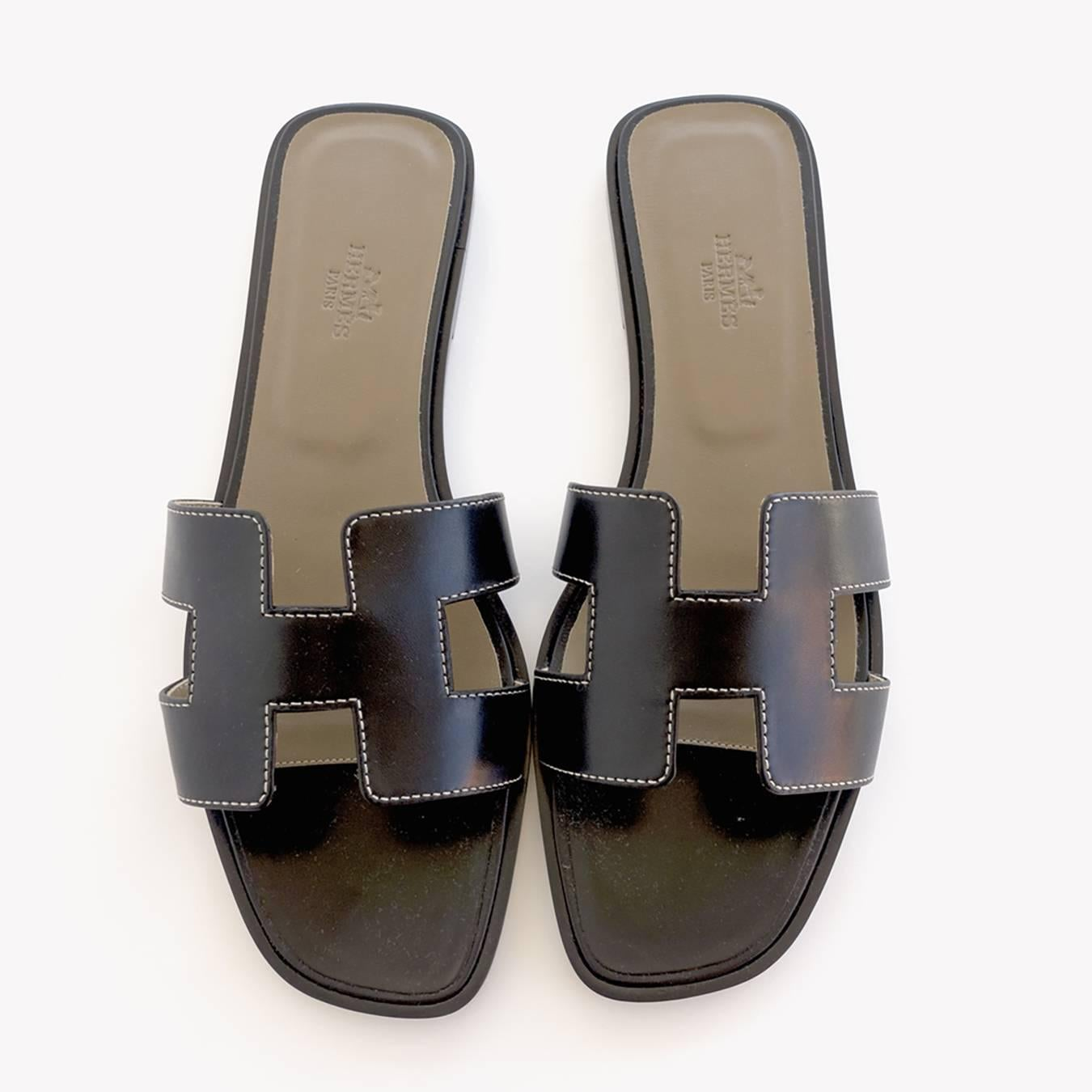 4d5920a7c5c2 Hermes Oran Black Box Leather Sandals White Stitching Size 40 or 3.9 or 10  at 1stdibs