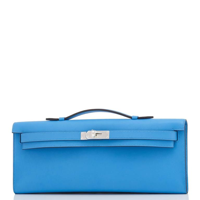 Hermes Blue Paradise Kelly Cut Pochette Clutch Swift Palladium Hardware Brand New in Box.  Store fresh. Pristine condition. Perfect gift! Comes with Hermes protective felt, sleeper, box and ribbon. Blue Paradise is one of the most gorgeous blues