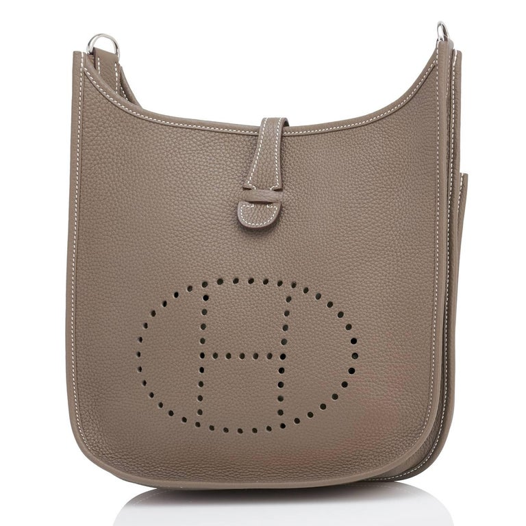Hermes Etoupe Evelyne PM 29cm Taupe Messenger Shoulder Bag Brand New in Box.  Store Fresh.  Pristine Condition. Perfect gift!  Comes with canvas shoulder strap, sleepers, and Hermes box. The ideal summer (and year-round) functional bag perfect for