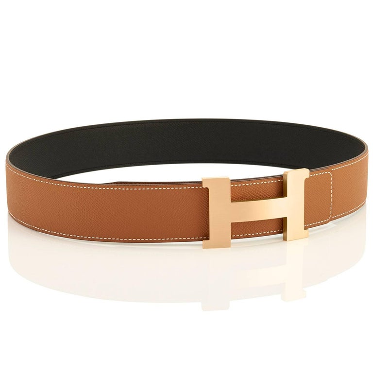 Hermes Belt Gold and Black Reversible Leather Gold Buckle Constance 42mm 85cm Brand New in Box. Store Fresh. Pristine Condition. Perfect gift! Belt kit comes with reversible belt strap, Hermes dust bag for belt buckle, and Hermes box Black on one