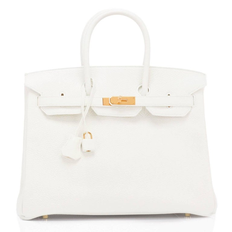 Hermes White 35cm Clemence Birkin Gold Hardware Exceedingly rare pristine condition White Birkin 35cm with Gold Hardware! Perfect gift! Comes full set with keys, lock, clochette, a sleeper for the bag, rain protector, and Hermes box. New or Never