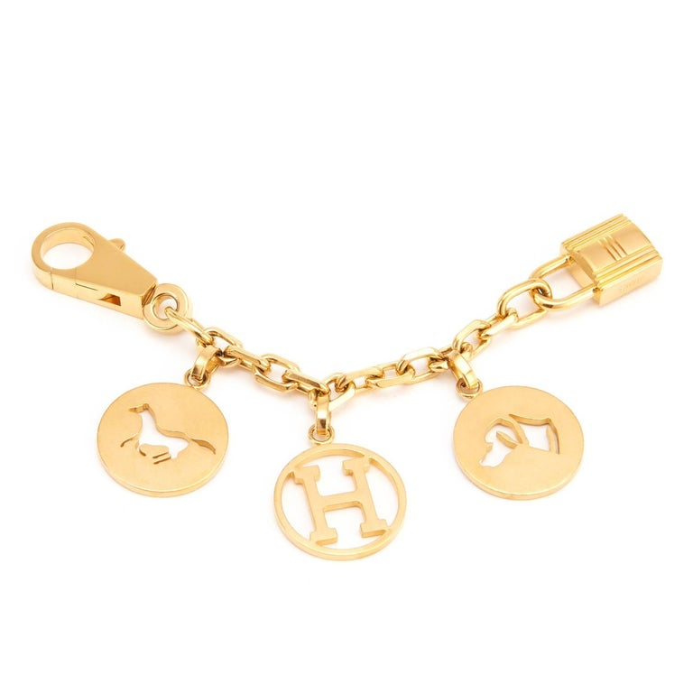 Hermes Breloque Charm Gold GHW Bag Charm for Birkin or Kelly   Extremely rare item. A most adorable Hermes bag charm in desirable GOLD for your Birkin or Kelly.  Featuring the iconic horse, dog, and H charms on a chain, the Breloque Charm is one of