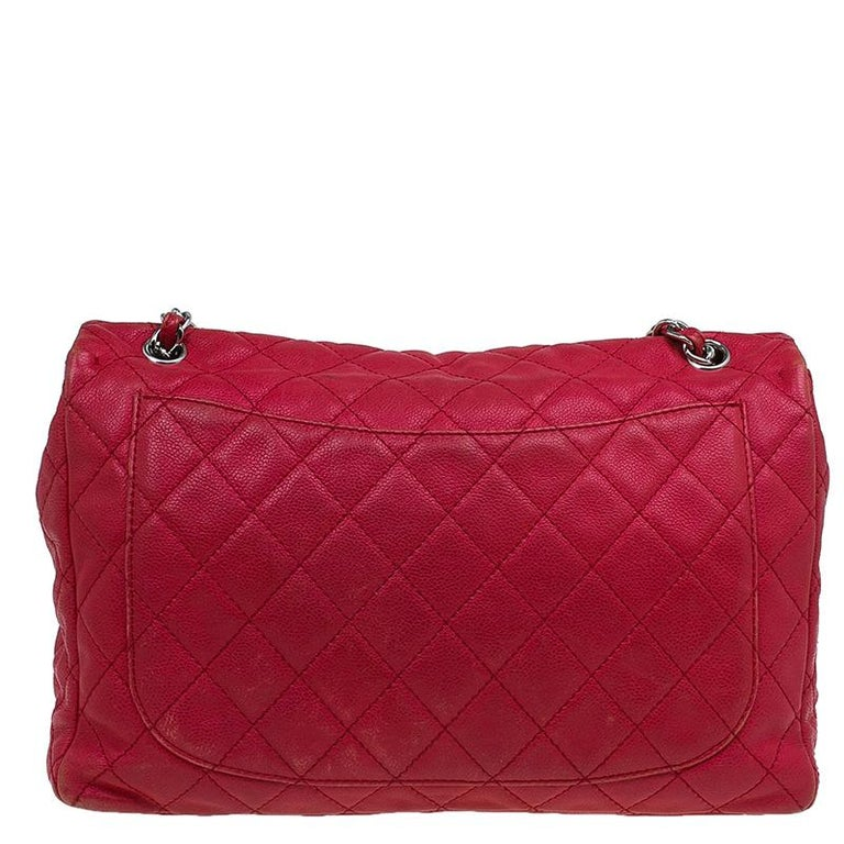 13e32aa88677d5 Chanel Red Washed Caviar Leather Maxi Jumbo XL Classic Flap Bag For Sale.  Relaxed yet refined, this gorgeous flap bag comes from the house of Chanel.