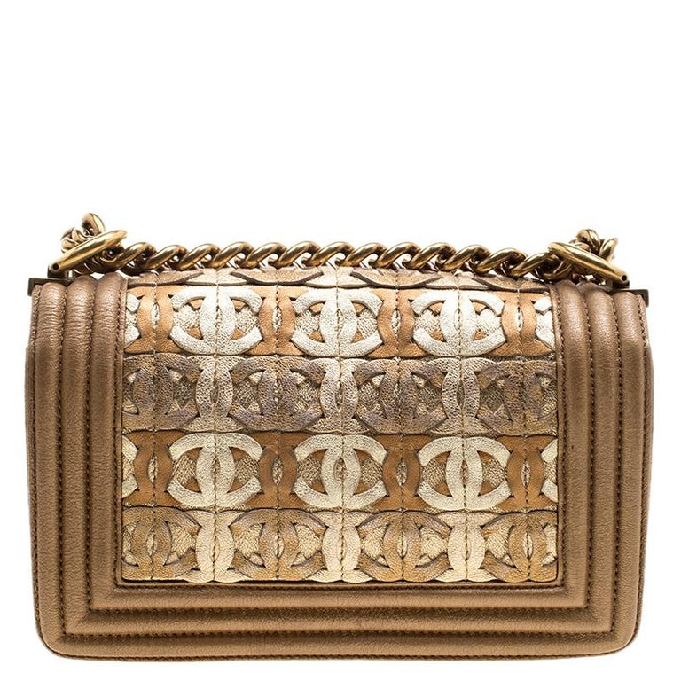 157572c2a75ecc Chanel Bronze Leather CC Cutout Small Boy Flap Bag For Sale. This  eye-catcher of a flap bag features a shiny, metallic gold leather with