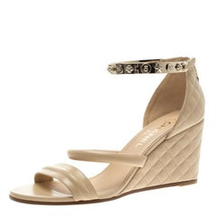 Chanel Beige Quilted Leather Charm Embellished Ankle Cuff Wedge Sandals Size 40.