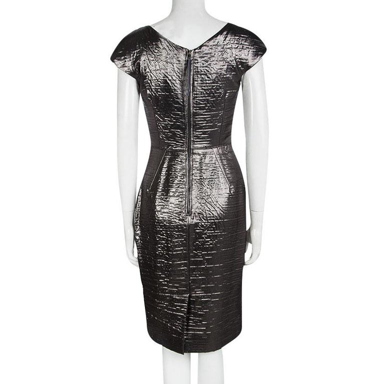 One glance and you'll fall in love with this shimmering metallic dress from Dolce and Gabbana.. The sheath dress is made of a silk blend and features a textured pattern all over it. With a well defined silhouette, it flaunts a rectangular neckline,