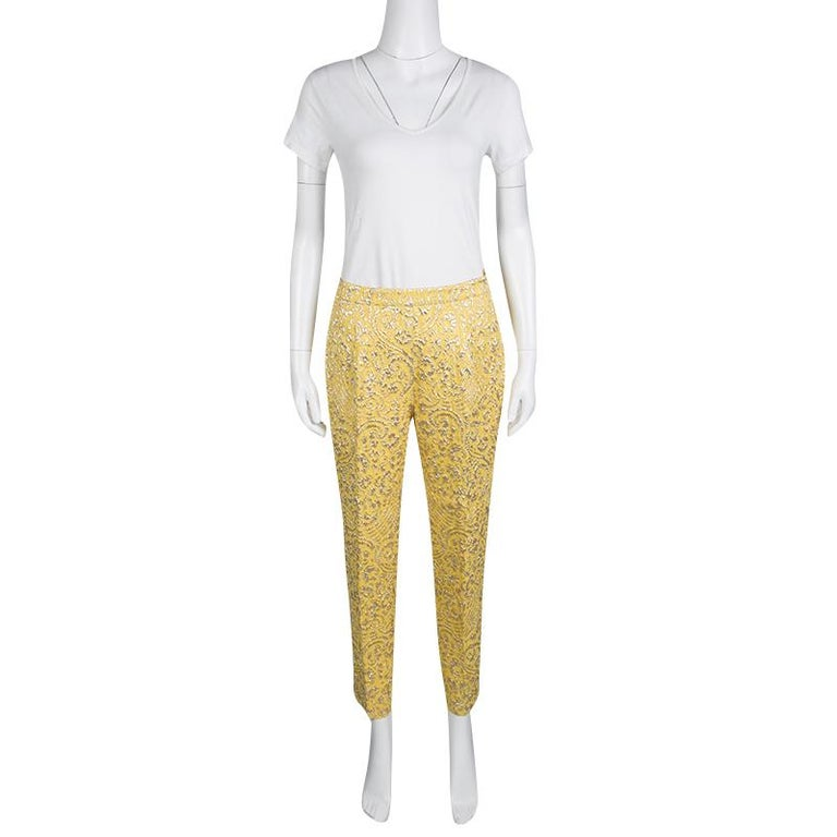 Cut from a silk blend with jacquard effect, these Dolce and Gabbana pants are a testament to the label's love for fine artistry and its Italian spirit. Floral lurex detail adorned these yellow pants that are ideal for a crisp evening look. They are