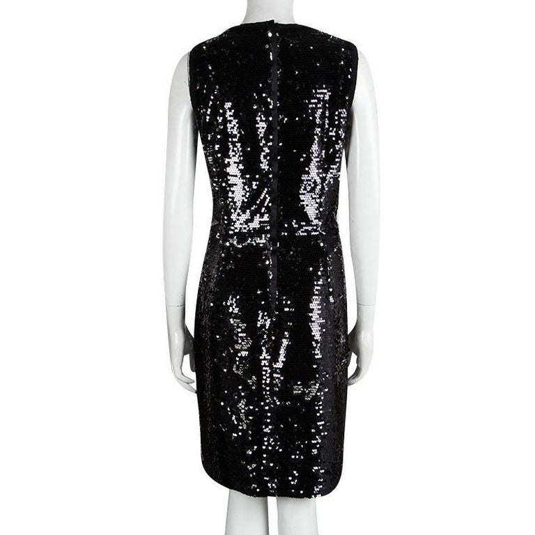 Dolce & Gabbana's black dress is embellished with tons of black sequins to really let it shine without the need for any accessories. Featuring a signature feminine silhouette, this knee length dress will steal the show at your evening soirees.