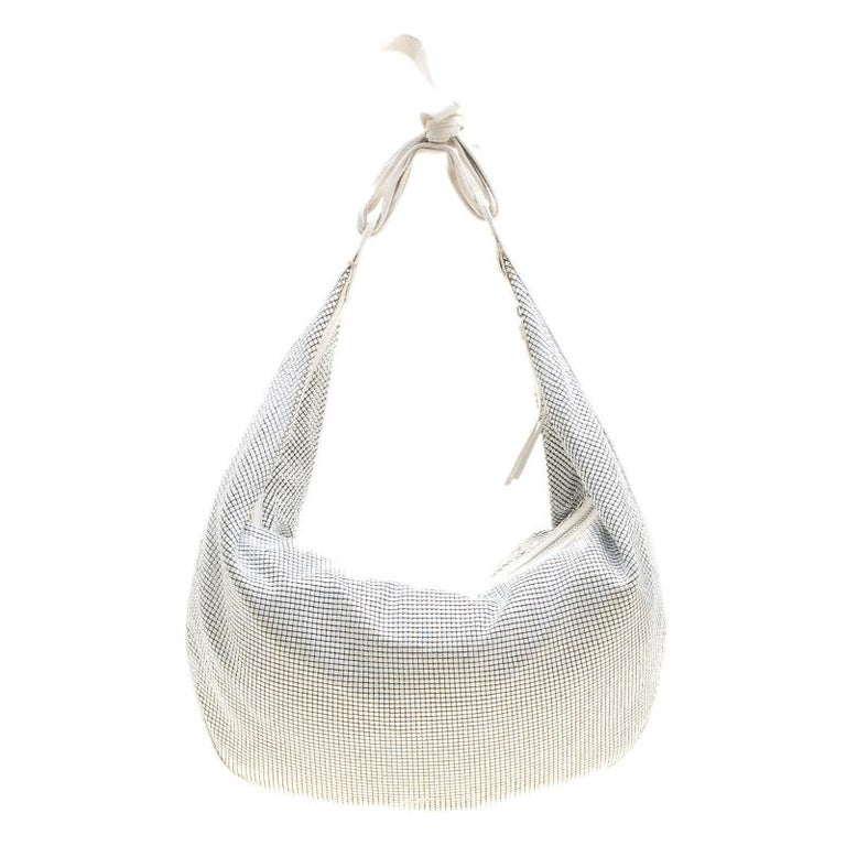 Fancy bags are a wardrobe must-have. Made in Italy, this hobo by Chloe has been crafted very artistically with metal in a mesh style. It also features a well-sized fabric interior and a single handle. This beauty is truly worth the
