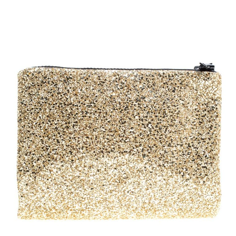 c8a0102f2ca522 Complete your party look with this clutch from Mawi. Fashioned in silver  glitter on the
