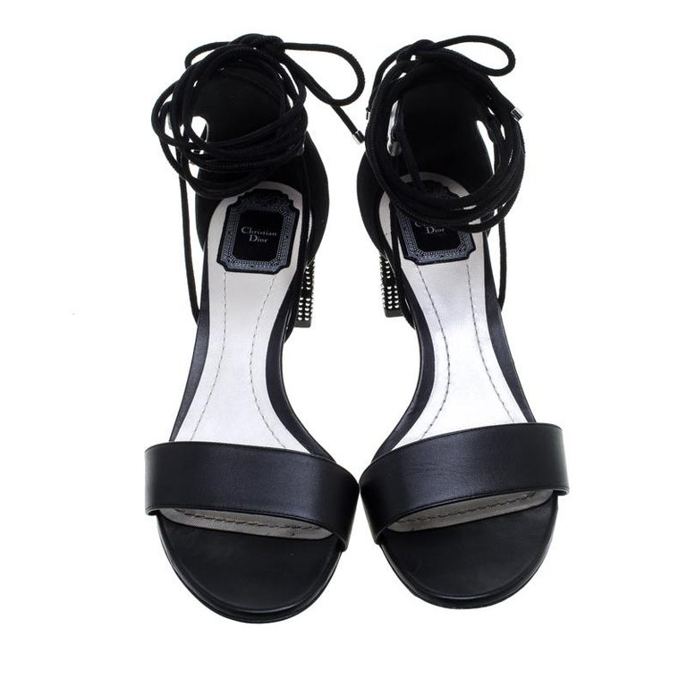 A perfect mix of elegant fashion and sensuous style, these Dior sandals come crafted from leather and detailed with lace-ups that end as a self-tie at the ankles and studded block heels. They're visually stunning and fashionable.  The Luxury Closet