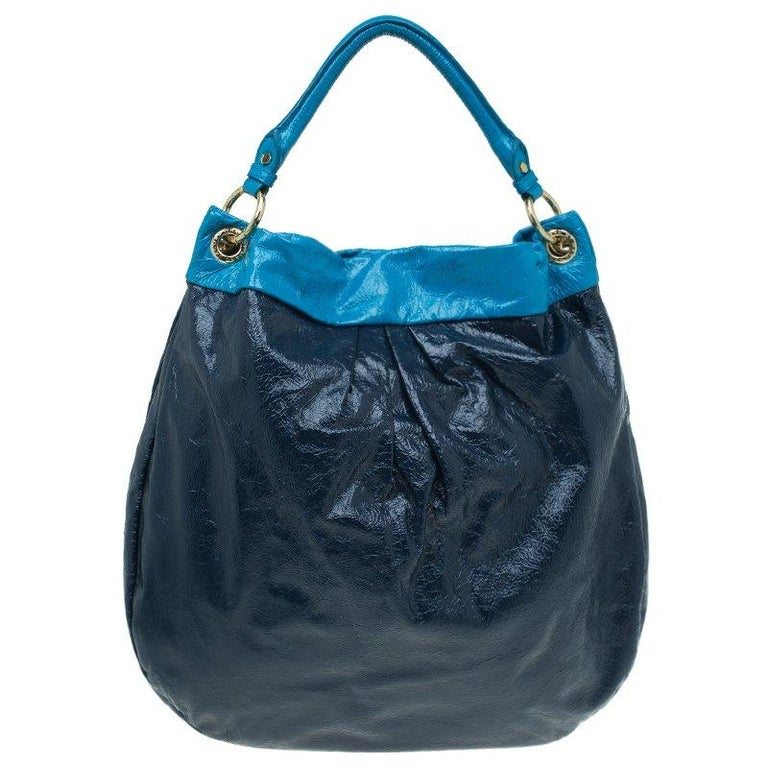 a0867556ddb Carry all of your essentials without bothering for space in this soft,  slouchy leather hobo