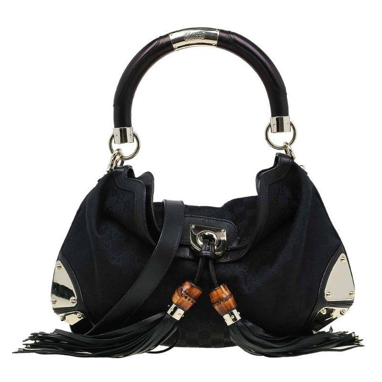 491e7073320 Gucci Black GG Canvas Medium Indy Top Handle Bag at 1stdibs