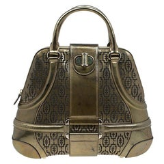 Alexander Mcqueen Gold Perforated Patent Leather Novak Satchel