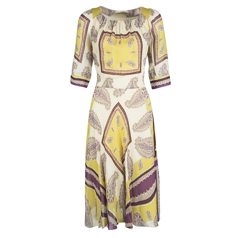 Watch your closet rejoice when you add this Etro dress to it! It is cut from silk and designed wonderfully with paisley prints, mid sleeves and tie detailing at the wist. You can flaunt it with a pair of block heels.  Includes: The Luxury Closet