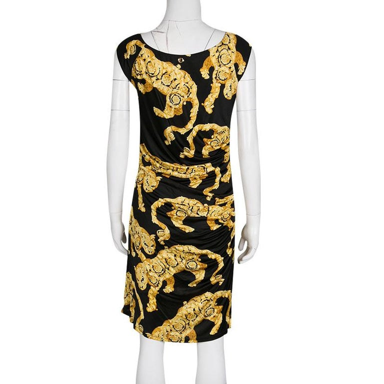 Lovely, isn't it? This dress by Versace Collection is so beautiful, you'll look high-fashion every time you slip into it. Keeping their famous signature of gold through the cat prints, the sleeveless dress is made complete with drape details. A