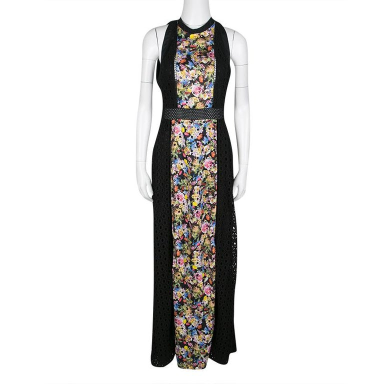 To infuse a groovy style into your elegant evening looks, pick this Alyss dress from Mary Katrantzou. It features a black cotton body detailed with eyelet embroidery and a floral printed center panel. A laced waistband to highlight the waist and