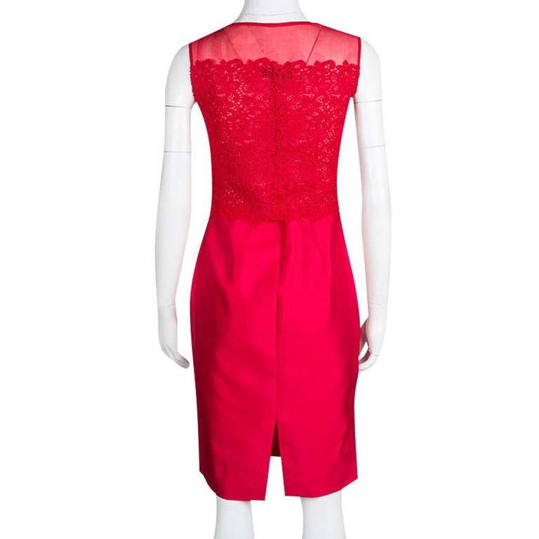CH Carolina Herrera sheath dress is all about feminine charm, grace, and subtlety. This red dress designed in a sleeveless style featuring beautiful lace bodice that goes sheer at the shoulders. Exuding a glossy effect, the outfit is cut from