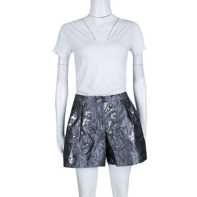 With ultra-glamorous women as its muse, Chanel holds the secret to chic evening style in these Damask shorts. Defined by the metallic finish, these shorts come crafted in a silk blend and carry a pleat detail along the front. A statement ruffle top