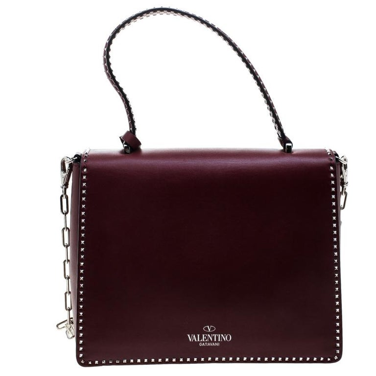90d0f0bb35 Catch admiring glances when you carry this Micro Rockstud handle bag from  Valentino! Crafted from