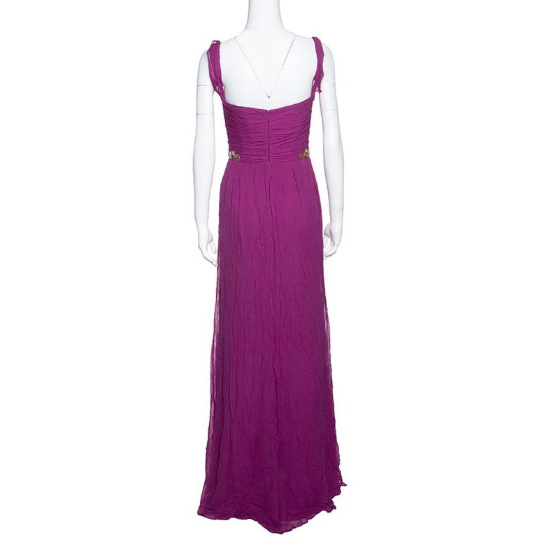 An apt choice for black-tie events and cocktail parties, this Grecian gown from Notte By Marchesa features a draped style bodice accented with pressed creases running down to a fluid chiffon bottom. The beautifully embellished waistline is the