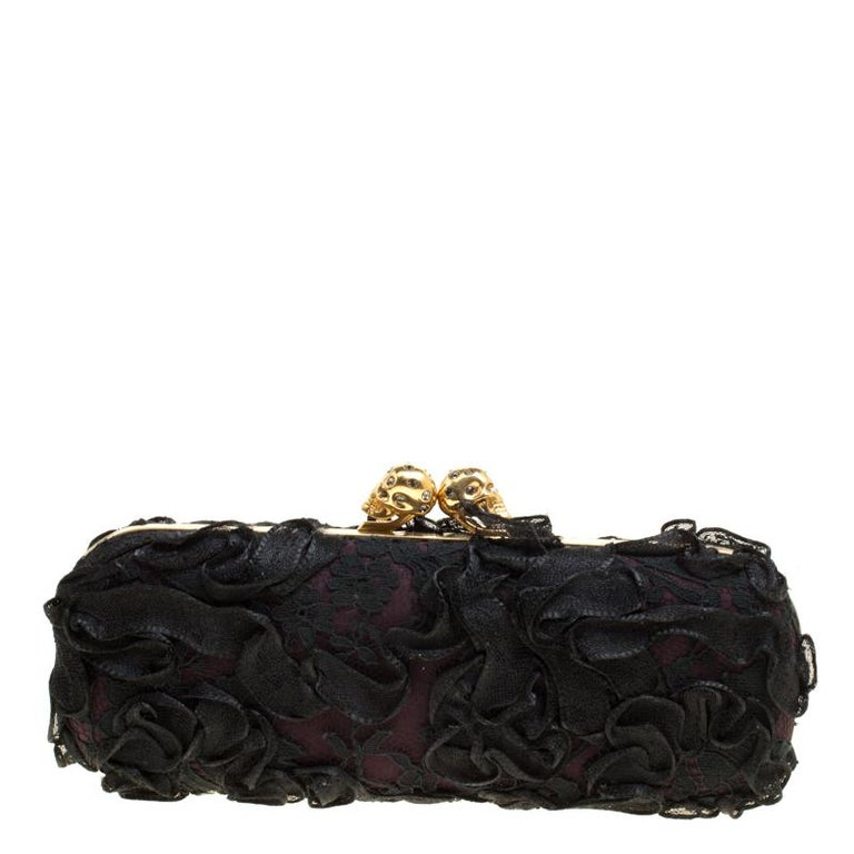 How utterly breathtaking is this clutch by Alexander McQueen! It is bold, well-crafted and overflowing with style. From the way it has been sculpted to the way it has been designed, this clutch makes a loud fashion statement with every detail. It