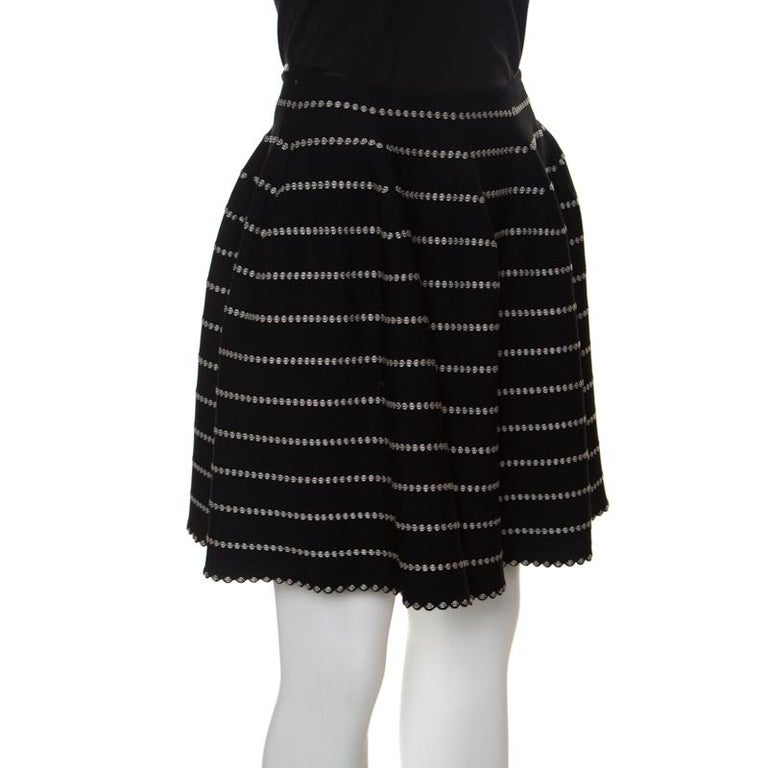 Who says only dresses can make you look chic and stylish when you have this fabulous mini skirt from Alaia that spells elegance. This high waist skirt is made of a blend of fabrics and features a monochrome embossed jacquard knit pattern all over