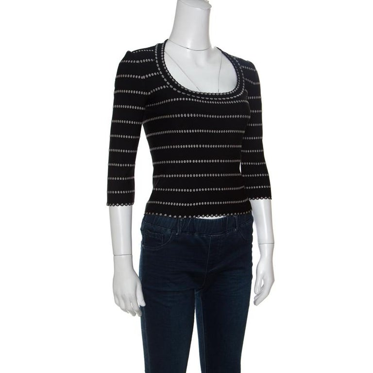 Your search for a chic and stylish top ends with this lovely one from Alaia. This top is made of a blend of fabrics and features a monochrome embossed jacquard knit pattern all over it. It flaunts a deep round neckline and long sleeves and comes